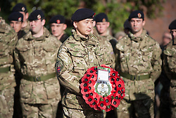 © London News Pictures. 11/11/12. Maidstone, Kent, Remembrance Day. A serving officer from the Queen's Gurkha Engineers holds a wreath in honour of those who have lost their lives in Afghanistan on Remembrance Day at the war memorial in Maidstone, Kent. Picture credit should read Manu Palomeque/LNP