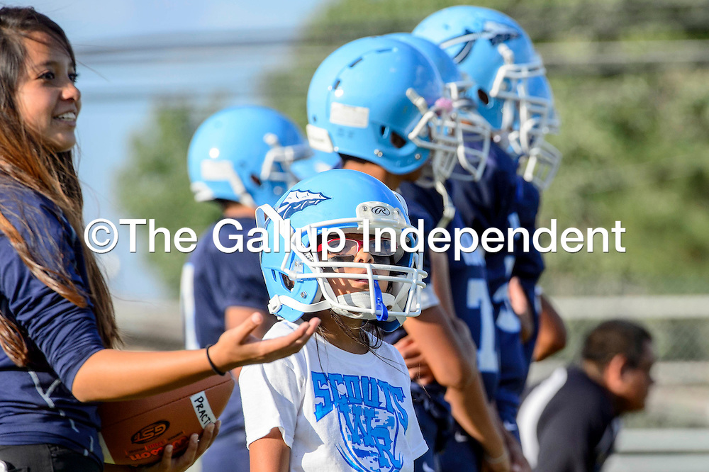 082115  Adron Gardner/Independent<br /> <br /> Danesha Henry, left, and Emily Pablo line up with the Window Rock Scouts during warmup before the Scouts faced off with the Payson Longhorns in Fort Defiance Friday.