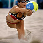 Holly McPeak dove for a loose ball during the bronze medal match in women's beach volleyball at the 2004 Summer Olympic Games at the Beach Volleyball Centre in Athens, Greece. McPeak and teammate Elaine Youngs won the bronze medal over Australia in three sets.