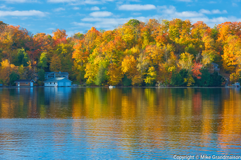Horseshoe Lake in autumn with cottage , Near Parry Sound, Ontario, Canada