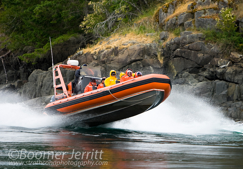 Guests on a Zodiak tour from nearby Painter's Lodge plow through the swift flowing, 14 plus knot, waters of Seymour Narrows during a full flood on the biggest tide of the year.  Seymour Narrows, Campbell River, British Columbia, Canada.