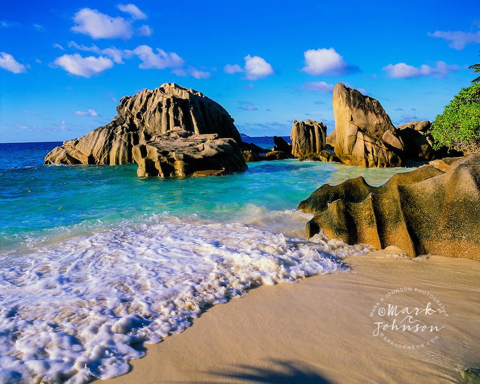 La Digue, Seychelles --- Beach and Rocky Coastline