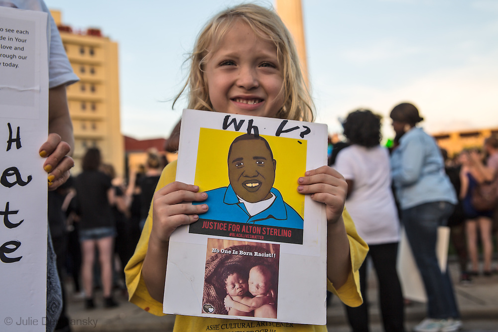 Theodore Boekiner, 6 at his first protest in New Orleans at Lee Circle against police brutality following the killing of Alton Sterling in Baton Rouge and Philando Castile in Minnesota on July 8, the day after 5 police officers will killed by a sniper in Dallas.