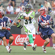 Jerry Ragonese #37 of the New York Lizards runs without a stick as Matt Smalley #11 of the Boston Cannons and Craig Bunker #22 of the Boston Cannons try to get the ball during the game at Harvard Stadium on July 19, 2014 in Boston, Massachusetts. (Photo by Elan Kawesch)