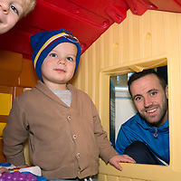 St Johnstone players visit Ward 10 (childrens ward) at the Perth Royal Infirmary handing out selection boxes and St Johnstone souvenir's to the children....08.12.14<br /> James McFadden pictured with brothers Oliver (5) and Struan Shepherd (2) in the playroom at Ward 10<br /> Picture by Graeme Hart.<br /> Copyright Perthshire Picture Agency<br /> Tel: 01738 623350  Mobile: 07990 594431