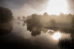 © Licensed to London News Pictures. 11/09/2016. Reading, UK.  The sun rises over a misty river Thames near Reading. A period of warm weather is expected in mid September.Photo credit: Peter Macdiarmid/LNP