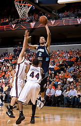 Old Dominion forward Gerald Lee (12) shoots over Virginia guard Sean Singletary (44).  The Virginia Cavaliers men's basketball team defeated the Old Dominion Monarchs 80-76 in the second round of the College Basketball Invitational (CBI) at the University of Virginia's John Paul Jones Arena in Charlottesville, VA on March 24, 2008.