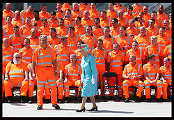 Image licensed to i-Images Picture Agency. 17/07/2014. Reading, United Kingdom. The Queen walks away after posing for a group photograph with construction workers after opening Reading Railway Station in Berkshire, United Kingdom, to mark a £895 million (pounds sterling)  re-development of the station.  Picture by Stephen Lock / i-Images
