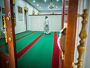 10 JULY 2015 - BANGKOK, THAILAND:  A man walks through Haroon Mosque in Bangkok before Iftar. Iftar is the evening meal when Muslims end their daily Ramadan fast at sunset. Iftar is a communal event at Haroon Mosque and hundreds of people usually attend the meal.    PHOTO BY JACK KURTZ