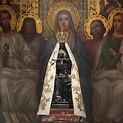 Statue of the Black Virgin, based on Ismeria, the Soudanese daughter of the sultan of Cairo El-Afdhal, who saved the lives of French knights during the Crusades, converted to christianity and married Robert d'Eppes, son of Guillaume II of France, on the High Altar, made 1610 in Italian Renaissance style, donated by Marie de Medici, wife of Henri IV, on the birth of Louis XIII, in the Basilica of Liesse Notre Dame, built 1134 in Flamboyant Gothic style by the Chevaliers d'Eppes, then rebuilt in 1384 and enlarged in 1480 and again in the 19th century, Liesse-Notre-Dame, Laon, Picardy, France. The statue of the Black Virgin and child stands in front of a fresco of the Pentecost. Picture by Manuel Cohen
