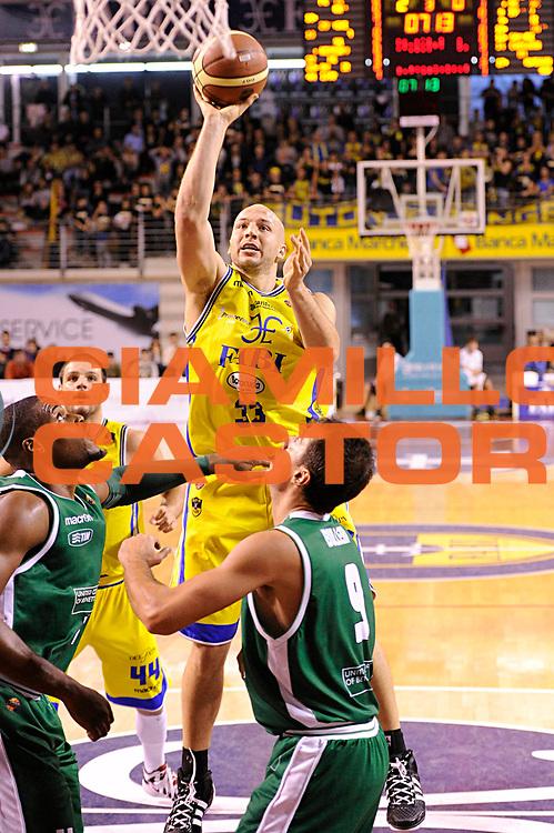 DESCRIZIONE : Ancona Lega A 2011-12 Fabi Shoes Montegranaro Benetton Treviso<br /> GIOCATORE : Greg Brunner<br /> CATEGORIA : tiro<br /> SQUADRA : Fabi Shoes Montegranaro<br /> EVENTO : Campionato Lega A 2011-2012<br /> GARA : Fabi Shoes Montegranaro Benetton Treviso<br /> DATA : 03/12/2011<br /> SPORT : Pallacanestro<br /> AUTORE : Agenzia Ciamillo-Castoria/C.De Massis<br /> Galleria : Lega Basket A 2011-2012<br /> Fotonotizia : Ancona Lega A 2011-12 Fabi Shoes Montegranaro Benetton Treviso<br /> Predefinita :