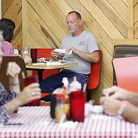 Thomas Wells   Buy at PHOTOS.DJOURNAL.COM<br /> Alan Merritt, center, and his wife, Yvonne enjoy their steak dinner at Ray Ray' Restaurant in Guntown.