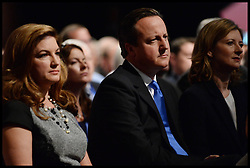 The Prime Minister David Cameron watching Chancellor of the Exchequer George Osborne's speech at the Conservative Party Conference in Manchester, United Kingdom. With Karren Brady (left) and George's wife Frances Osborne Monday, 30th September 2013. Picture by Andrew Parsons / i-Images