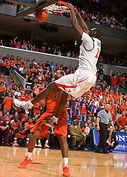 Virginia center Tunji Soroye (21) dunks against VT.  The Virginia Cavaliers defeated the Virginia Tech Hokies 75-61 at the John Paul Jones Arena on the Grounds of the University of Virginia in Charlottesville, VA on February 18, 2009.