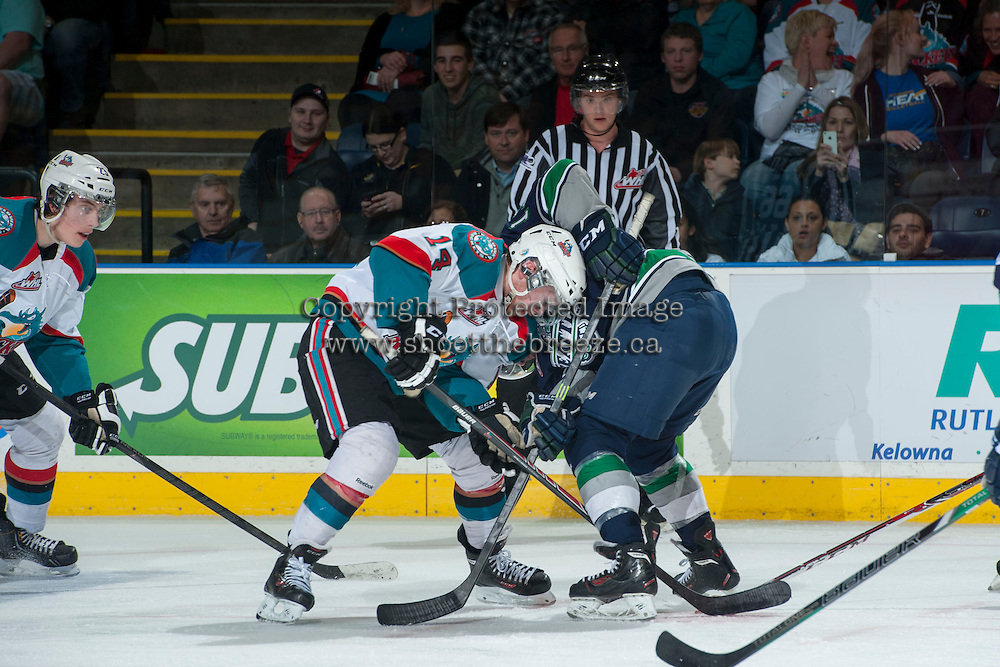 KELOWNA, CANADA - APRIL 5:  Rourke Chartier #14 of the Kelowna Rockets digs for the puck after the face off against the Seattle Thunderbirds on April 5, 2014 during Game 2 of the second round of WHL Playoffs at Prospera Place in Kelowna, British Columbia, Canada.   (Photo by Marissa Baecker/Getty Images)  *** Local Caption *** Rourke Chartier;