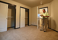 Kevin Hunter of Hunter Appraisal Service makes notes as he stands in a bedroom of a new construction home at 403 Cimarron Drive, in Hiawatha on Friday morning, June 29, 2012.