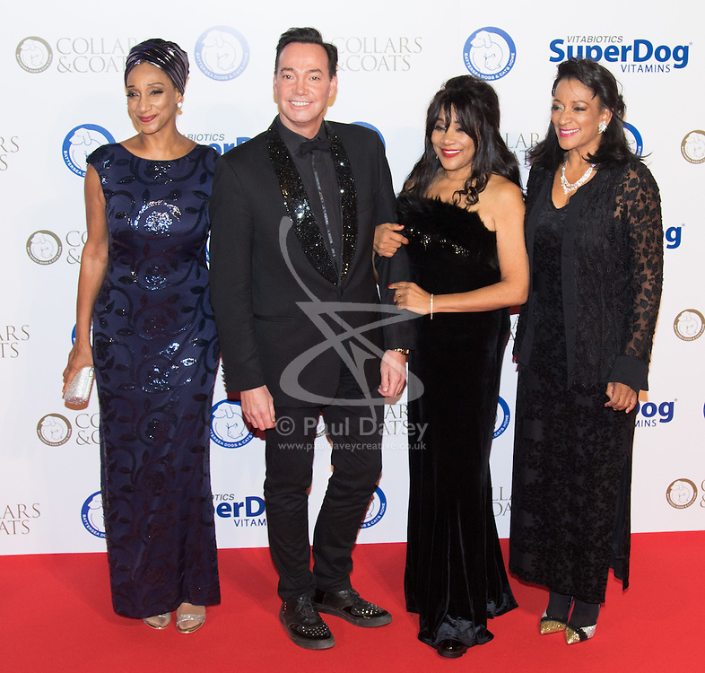 "Battersea, London, November 3rd 2016.  Celebrities and their dogs attend The Evolution at Battersea Park to attend The Battersea Dogs and Cats Home ""Collars and Coats Ball"". PICTURED: Sister Sledge and Craig Revell-Horwood"
