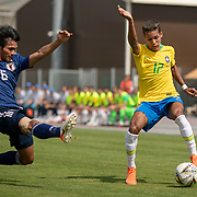 TOULON, FRANCE June 15.  Pedrinho #17 of Brazil defended by Yaichi Naganuma #6 of Japan during the Brazil U22 V Japan U22 Final match at the Tournoi Maurice Revello at Stade D'Honneur on June 15th 2019 in Toulon, Provence, France. (Photo by Tim Clayton/Corbis via Getty Images)