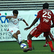 Orlando City Lions MIdfielder Lewis Neal (24) kicks the ball for a goal against Henry Kalungi (25)  during a United Soccer League Pro soccer match between the Richmond Kickers and the Orlando City Lions at the Florida Citrus Bowl on May 25, 2011 in Orlando, Florida.  (AP Photo/Alex Menendez)