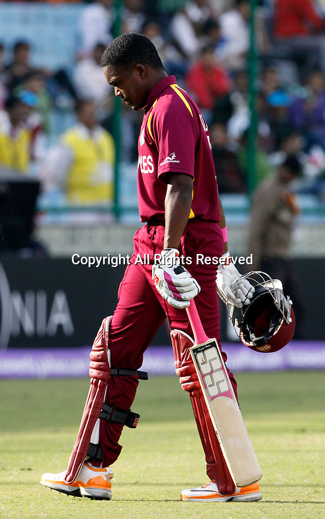 28.02.2011 Cricket World Cup from the Feroz Shah Kotla stadium in Delhi. West indies v Netherlands. Dwayne Bravo walks back after getting out during the match of the ICC Cricket World Cup between Netherlands and West Indies on the 28th February 2011