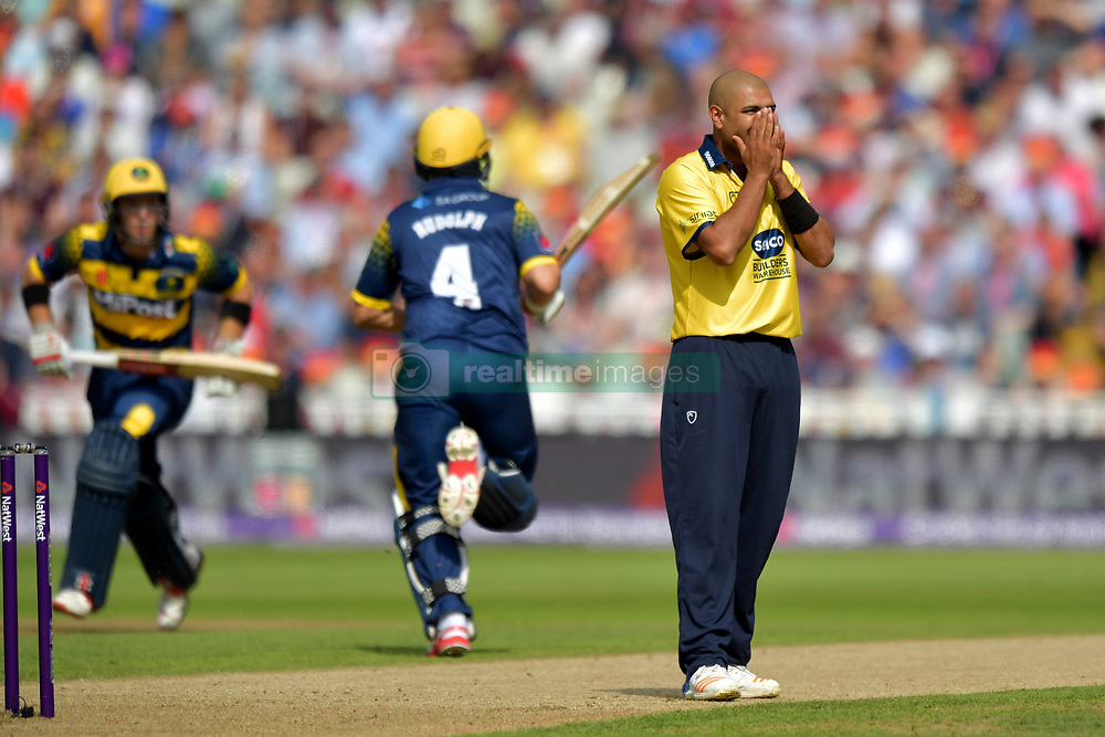 Birmingham's Jeetan Patel reacts as Glamorgan's Colin Ingram and Jacques Rudolph run between the wickets during the NatWest T20 Blast Finals Day at Edgbaston, Birmingham.