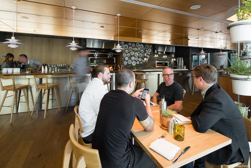 Michael Schwartz meets with his team at  his latest restaurant, Fi'lia, located at SLS Brickell in Miami.