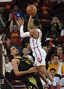 Feb 15, 2018; Los Angeles, CA, USA; Southern California Trojans guard Jordan McLaughlin (11) shoots  the ball as Oregon Ducks forward Paul White (13) defends in the first half during an NCAA basketball game at Galen Center. USC defeated Oregon 72-70.