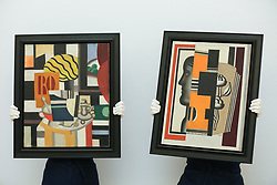 © Licensed to London News Pictures. 29/01/2020. London, UK. Technicians hold Fernand Leger's painting titled Nature Morte (L) (est £2.2m to £2.8m) and Fernand Léger's painting tilted Le Buste (R) (est £1.3m to £1.6m) at the preview of Sotheby's Impressionist, Modern and Surrealist art sales. The auction will take place at Sotheby's in central London on 4 and 5 February 2020. Photo credit: Dinendra Haria/LNP