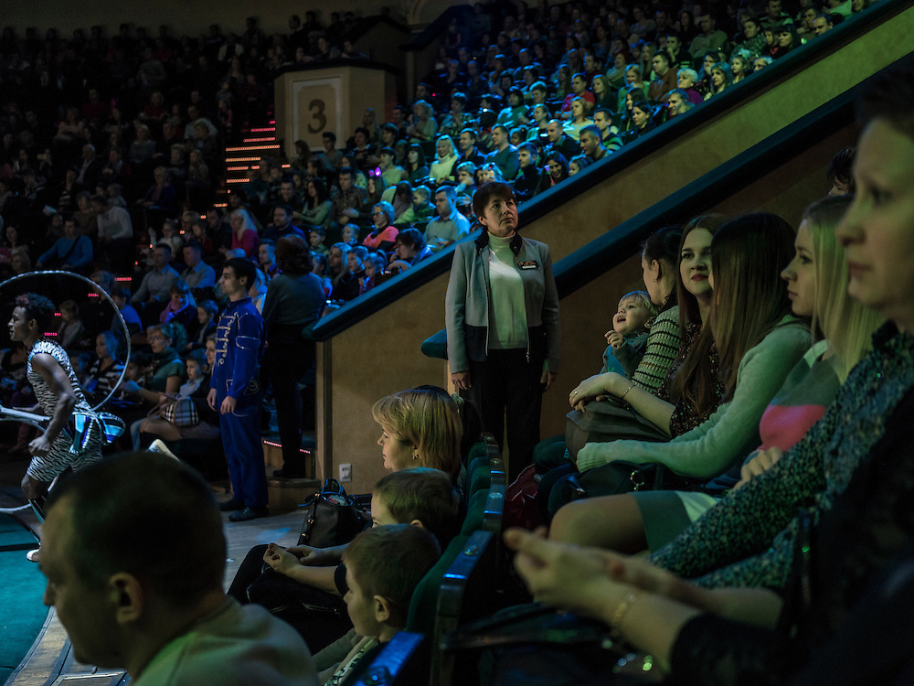 "Audience members and an attendant watch the Belarus State Circus peformance of a show titled ""Africa!?!"" on Wednesday, November 25, 2015 in Minsk, Belarus."