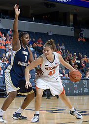 Virginia Cavaliers F Kelly Hartig (42) dribbles in the paint against George Washington Colonials C/F Jessica Adair (1).  The Virginia Cavaliers women's basketball team fell to the #14 ranked George Washington Colonials 70-68 at the John Paul Jones Arena in Charlottesville, VA on November 12, 2007.