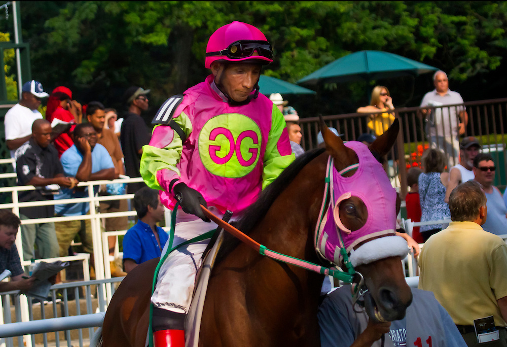 """""""Chop, Chop"""" aka Jorge Chavez, is up on """"Kingsdale Ocean"""" in the post parade at Belmont Park in July of 2011. He last rode in December of that year, when he had a career ending accident. Jorge was long a New York favorite, and had over 4000 career winners, including the Kentucky Derby."""