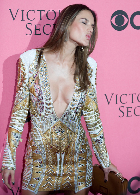 Victoria's Secret Angel Miranda Kerr poses for photos on the Pink Carpet before Tuesday's screening party for the 2011 Victoria's Secret Fashion Show.