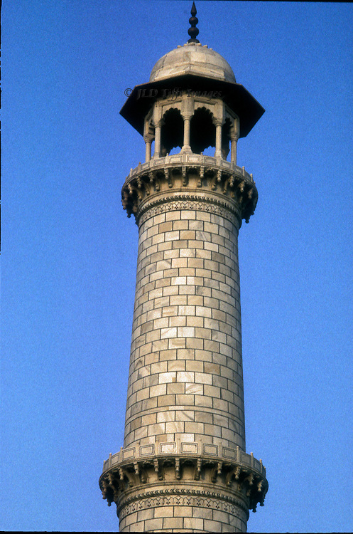 Upper part of a minaret at the Taj Mahal, showing fine ashlar masonry and delicate carved detail.