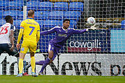 A save by Nathan Trott of Wimbledon  during the EFL Sky Bet League 1 match between Bolton Wanderers and AFC Wimbledon at the University of  Bolton Stadium, Bolton, England on 7 December 2019.