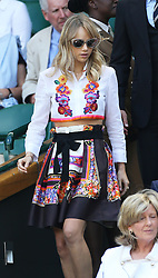 Image licensed to i-Images Picture Agency. 04/07/2014. London, United Kingdom.  Suki Waterhouse and Bradley Cooper arriving in the Royal box  on day eleven of the Wimbledon Tennis Championships . Picture by Stephen Lock / i-Images