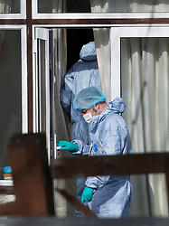 © Licensed to London News Pictures. 14/03/2018. London, UK. Police wearing protective clothing work at the rear of the house of Russian exile Nikolai Glushkov as they continue their investigation in south west London. Mr Glushkov, a friend of oligarch Boris Berezovsky, and a former deputy director of Russian state airline Aeroflot, died at his home in Monday night. Photo credit: Peter Macdiarmid/LNP