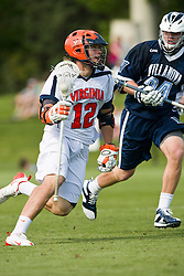 Virginia Cavaliers M/A John Haldy (12) is defended by Villanova Wildcats Defense Ross Reitz (34).  The #5 ranked Virginia Cavaliers defeated the #19 ranked Villanova Wildcats 18-6 in the first round of the 2008 NCAA Men's Lacrosse Tournament the University of Virginia's Klockner Stadium in Charlottesville, VA on May 10, 2009.