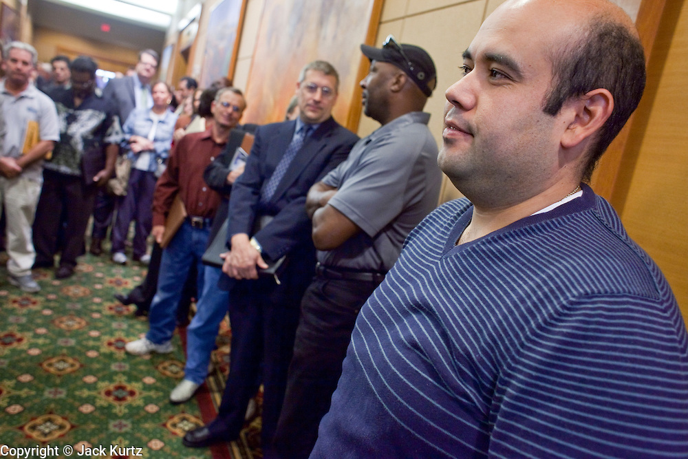 23 February 2009 -- PHOENIX, AZ:  MARTIN MONGE, from Tempe, AZ, and others wait to get into a job fair sponsored by National Career Fairs in the Marriott Hotel in Phoenix Monday. Monge said he's been out of work for about a month. More than 1,500 people lined up for a chance to turn in a resume and be interviewed by the 21 firms who had booths at the job fair. According to the US Bureau of Labor Statistics, unemployment in Arizona increased from 3.9 percent in April 2008 to 6.9 percent in December 2008.    Photo By Jack Kurtz / ZUMA Press