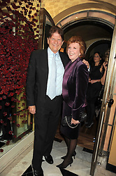 CILLA BLACK and JOHN MADEJSKI at a party to celebrate the 10th Anniversary of Claridge's Bar, Claridge's Hotel, Brook Street, London on 11th November 2008.
