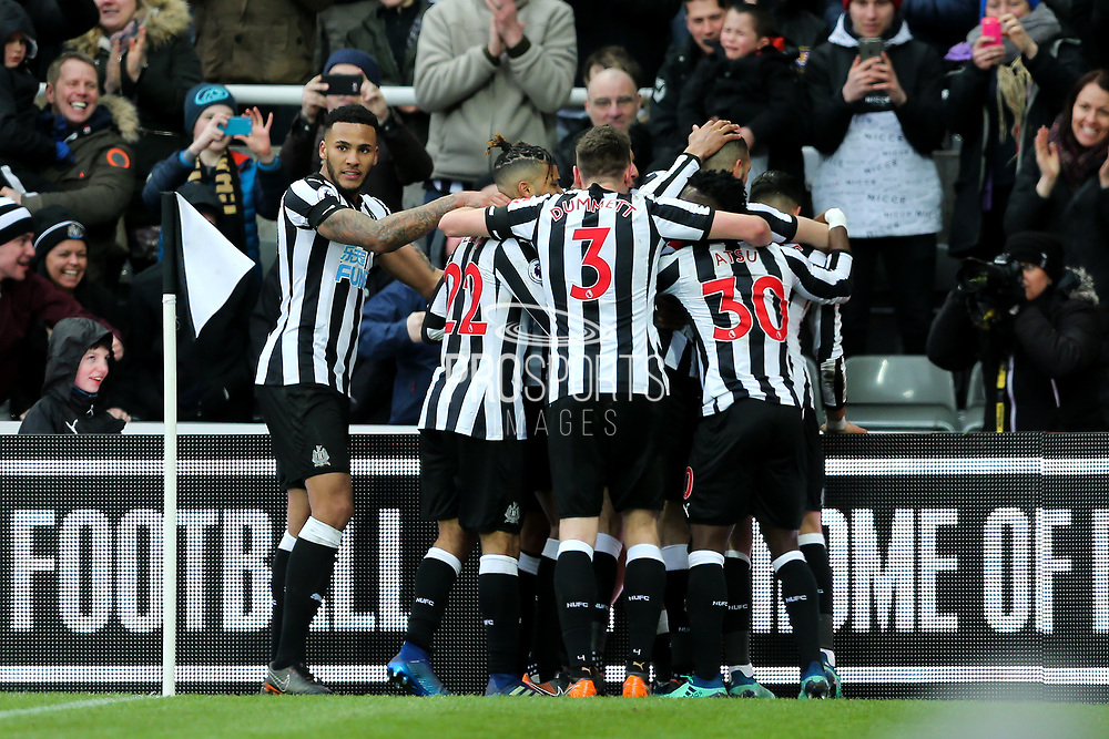 Ayoze Perez (#17) of Newcastle United celebrates Newcastle United's first goal (1-0) with Newcastle United players during the Premier League match between Newcastle United and Huddersfield Town at St. James's Park, Newcastle, England on 31 March 2018. Picture by Craig Doyle.