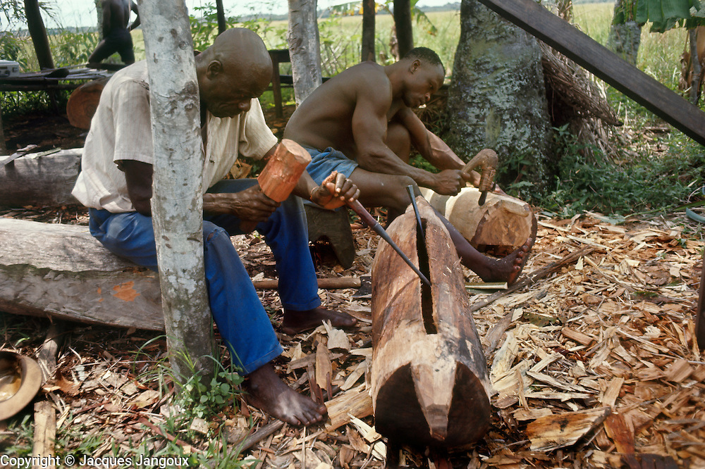 Men of Libinza tribe making mokoto drums, Ngiri River area, Democratic Republic of the Congo (ex Zaire).