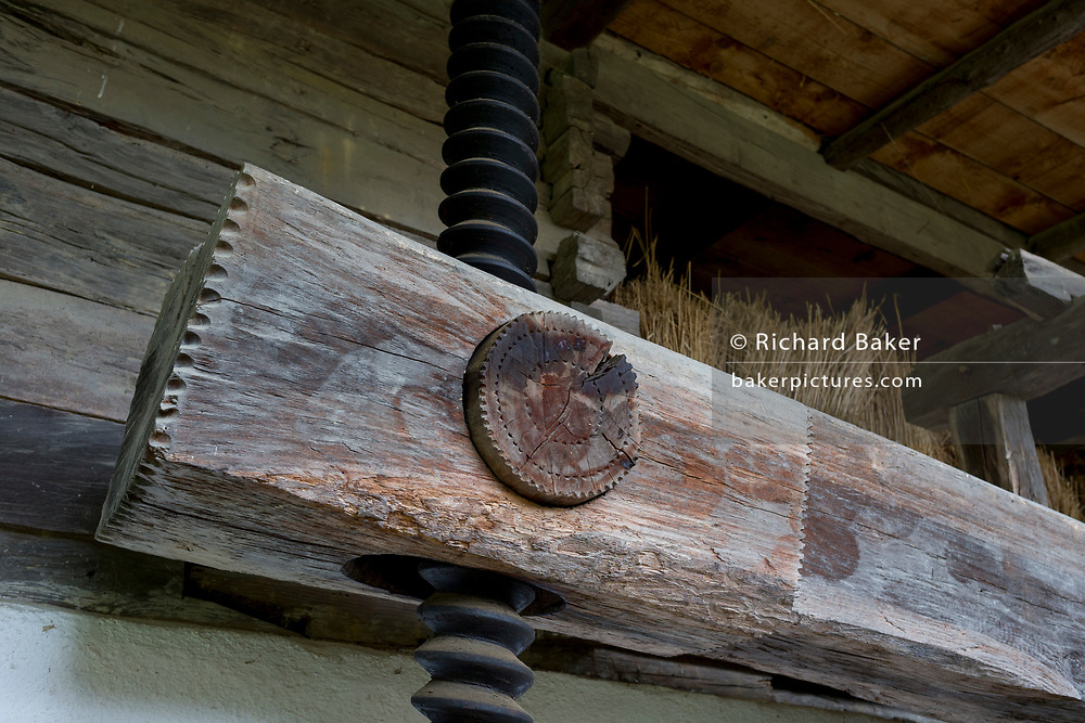 The wine press in the traditional Slovenian Barn at the Rogatec Open Air Museum, very close to the Croatian border, on 24th June 2018, in Rogatec, Slovenia. The museum of relocated and restored 19th and early 20th century farming buildings and houses represents folk architecture in the area south of the Donacka Gora and Boc mountains.