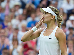 30.06.2014, All England Lawn Tennis Club, London, ENG, WTA Tour, Wimbledon, im Bild Eugenie Bouchard (CAN) celebrates after winning the Ladies' Singles 4th Round match 7-6 (5), 7-5 on day seven // 15065000 during the Wimbledon Championships at the All England Lawn Tennis Club in London, Great Britain on 2014/06/30. EXPA Pictures © 2014, PhotoCredit: EXPA/ Propagandaphoto/ David Rawcliffe<br /> <br /> *****ATTENTION - OUT of ENG, GBR*****