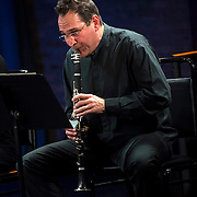 """February 9, 2015 - New York, NY : Clarinetist Mark Nuccio performs in the New York premiere of Avner Dorman's 'Jersusalem Mix' as part of The New York Philharmonic and the 92nd Street Y's presentation of """"Contact! New Music from Israel"""" at SubCulture in Manhattan on Monday night.  CREDIT: Karsten Moran for The New York Times"""