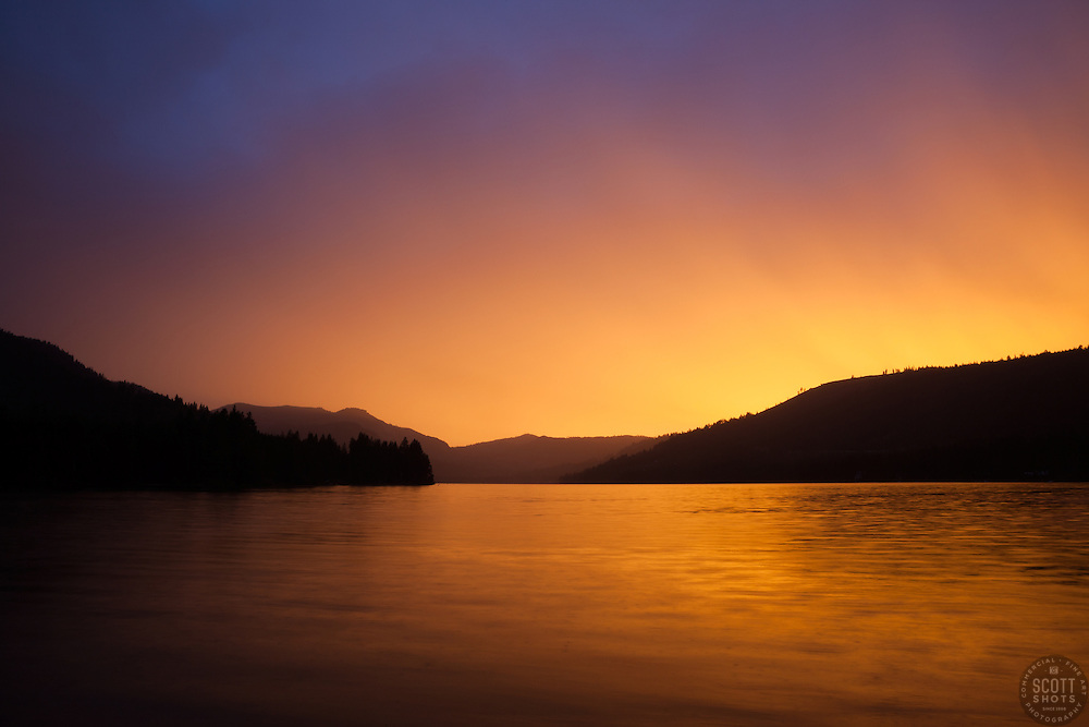 """""""Donner Lake Sunset 18"""" - Photograph of a very bright sunset at Donner Lake, shot from the East end."""