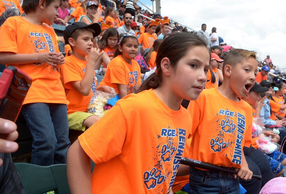 gbs050917a/SPORTS -- Los Lunas Elementary first graders Leiah Garibay, 7, left, and Jeriko Olguin, 7, watch the game at Isotopes Park on Tuesday, May 9, 2017. (Greg Sorber/Albuquerque Journal)