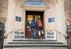 © Licensed to London News Pictures. 12/12/2019. Bristol, UK. General Election 2019; People go to the polls with umbrellas in the rain on election day in Bristol city centre with polling stations at the Central Library and City Hall. Photo credit: Simon Chapman/LNP.