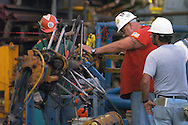KEVIN BARTRAM/The Daily News.Workers repair a cutting tool used to cut the legs of an offshore platform on Monday, June 27, 2005. The eight legs of an El Paso Corporation platform were cut about 90 feet below the surface of the Gulf of Mexico so the top half of the platform could be placed on the floor of the gulf to form an artificial reef.