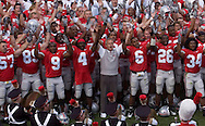 MORNING JOURNAL/DAVID RICHARD<br />Ohio State head coach Jim Tressel and his squad sing &quot;Carmen Ohio&quot; after yesterday's win over Miami.