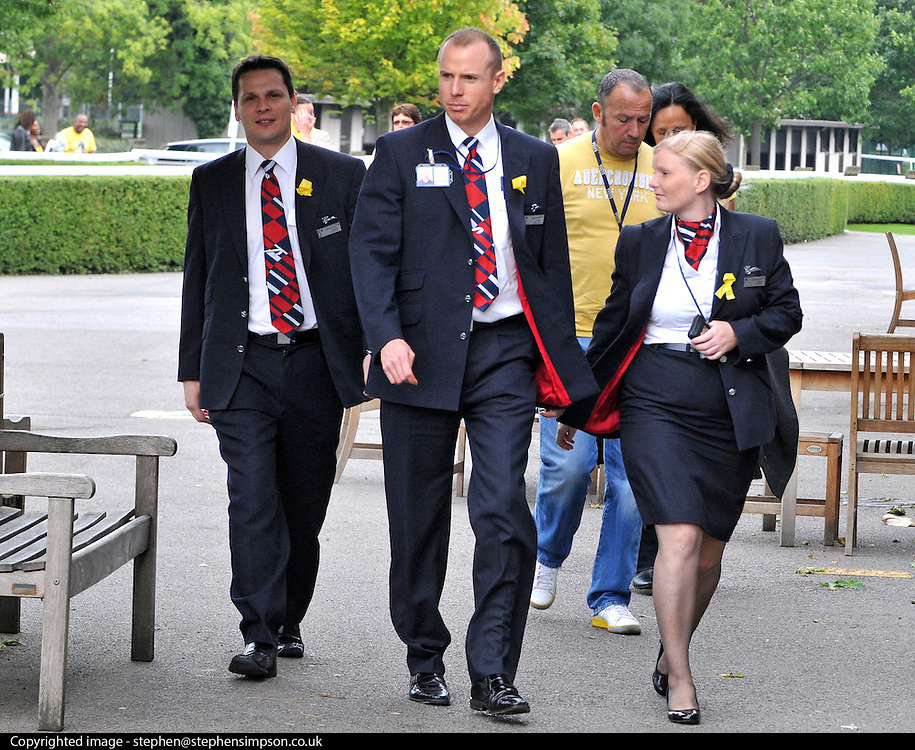 KEMPTON RACECOURSE. SURREY. Members of BA cabin crew arrive at a union meeting at Kempton Racecoure in Surrey on the 6th September 2010. Union memebrs were asked to wear the colour yellow and further ballot action for strikes was on the agenda for the meeting. 06 SEPT 2010. STEPHEN SIMPSON ..
